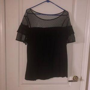 Black mesh polka dot shirt. Top=mesh bottom=cotton